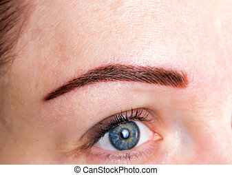 woman with brow tattoo - closeup of the permanent brow ...