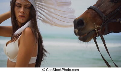 Woman with brown horse at the beach - Sensual brunette woman...