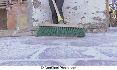 Woman with brush clean yard