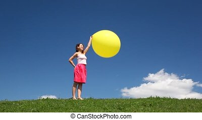 Woman with bubble stands on grass