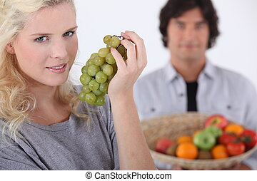 Woman with bunch of grapes