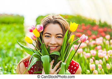woman with bunch of tulip flowers
