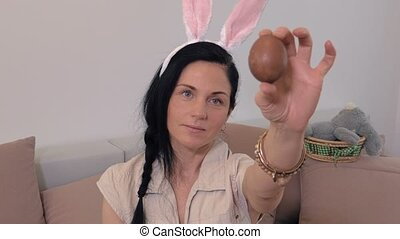 Woman with bunny ears and Easter egg