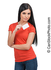 Woman with business card. Confident young black hair woman holding business card while standing isolated on white