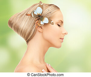 woman with butterfly in hair