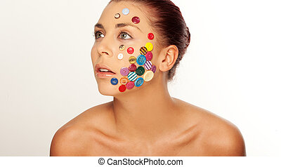 Woman with buttons on her face - Attractive woman, with...