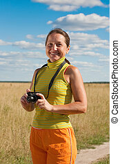 woman with camera at  field