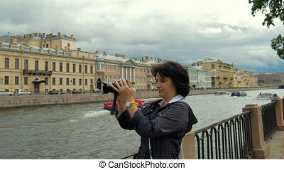 Woman with camera on the street. - Woman on the street...