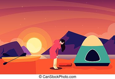 woman with camping tent on the river shore