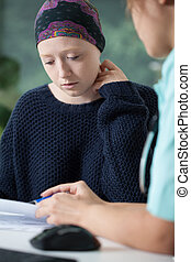 Woman with cancer during medical appointment, vertical