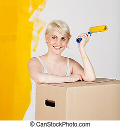 Woman With Cardboard Box And Paint Roller