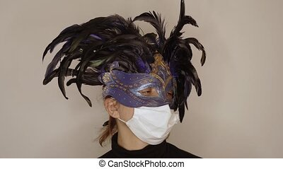 Woman wears carnival mask and mask for the virus