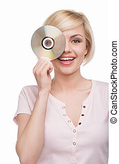 Woman with CD disk. Beautiful young blond hair woman holding CD disk in front of her face and smiling while isolated on white