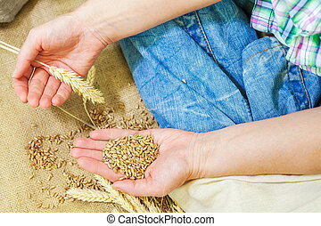 Woman with cereals seeds in her hands