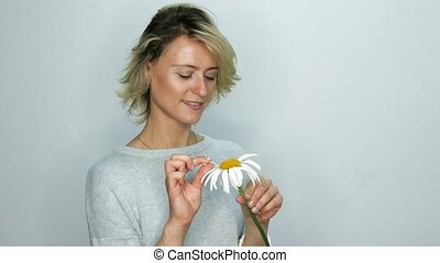 Woman with chamomile - Pretty woman holds chamomile flower...