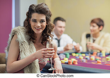 Woman with champagne smiling