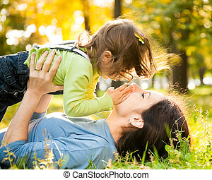 Woman with child in autumn