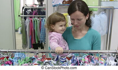 Woman with child in clothing store
