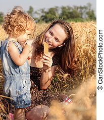 Woman with child in field