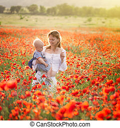 Woman with child in field with poppies