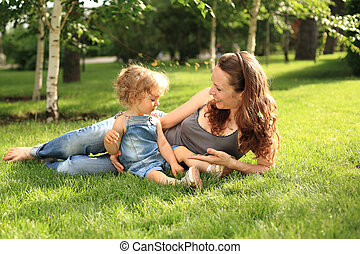 Woman with child in summer park