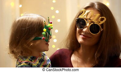 Woman with child in sunglasses with the number 2019 and...
