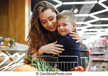 Woman with child in supermarket