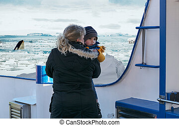 Woman with child on a ship during a polar trip.