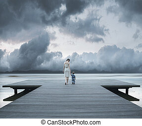 Woman with child on the pier