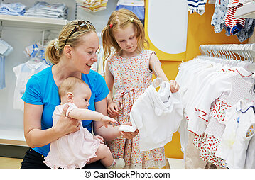 woman with children in shop