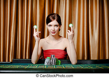 Woman with chips at the casino table