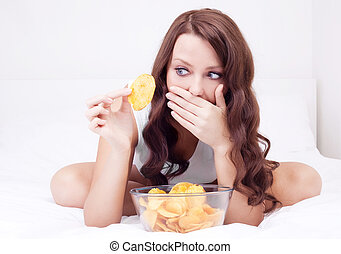 woman with chips - pretty woman eating potato chips in bed ...