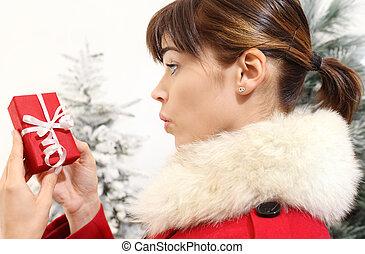woman with Christmas gift, amazed
