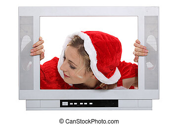 Woman with Christmas hat behind TV