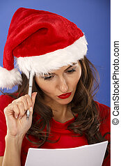 woman with Christmas hat with a list in hand