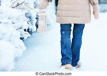 Woman with Christmas lantern