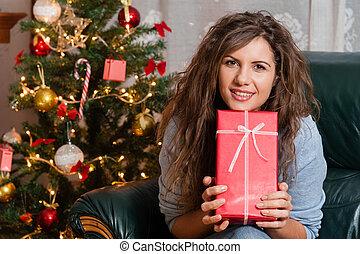 Woman with christmas present box