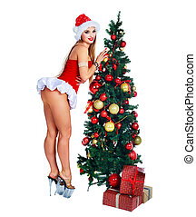 woman with Christmas tree - beautiful young woman wearing a...