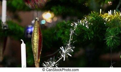 Woman with christmas tree decoratio