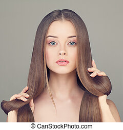 Woman with Clear Skin and Long Healthy Hair