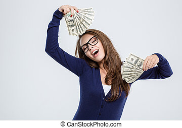 Woman with closed eyes holding money - Portrait of a happy...