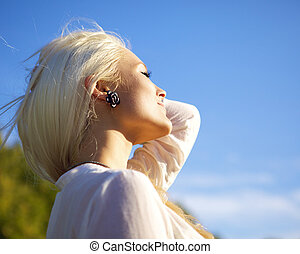 Woman with closed eyes relaxing in sun