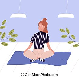 Woman with closed eyes sitting cross legged and meditating. ...