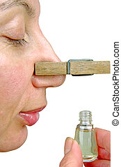 Woman with clothespin in the nose Perfume bottle