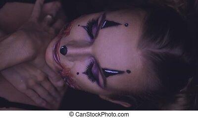 Woman with clown Halloween makeup - Closeup face of woman...