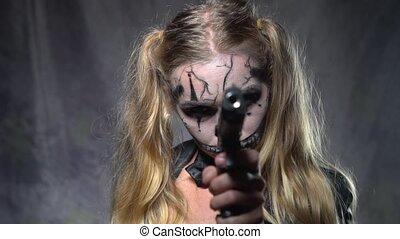Woman with clown skull Halloween makeup - Closeup face of...