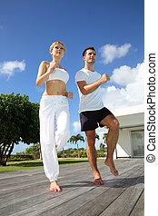 Woman with coach exercising outside