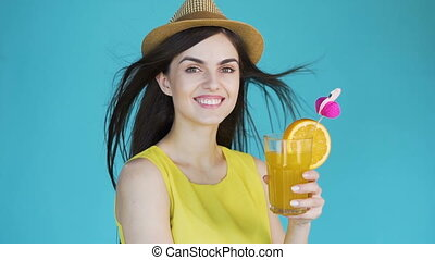 Woman with Cocktail - Attractive brunette holding tasty...
