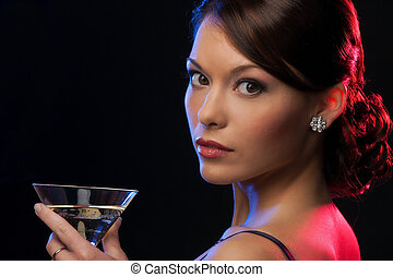 woman with cocktail - beautiful woman in evening dress with...