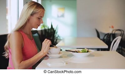 woman with coffee calling smartphone at restaurant - food,...